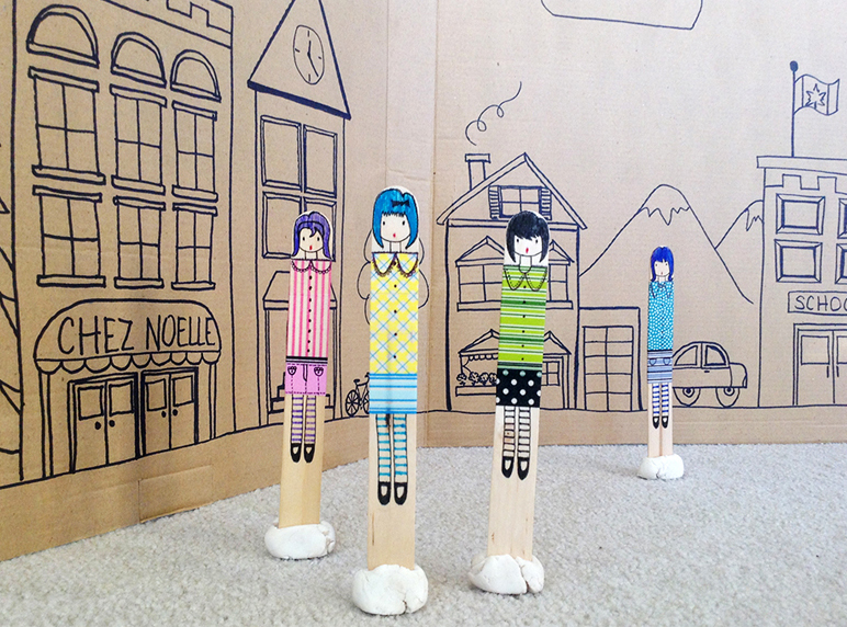 The dolls playing in their custom made town.