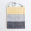 This color block bag is small and convenient to carry around, while still being roomy enough to fit all of your essentials. #crochetbag #crochetpattern #crochetlove #crochetaddict