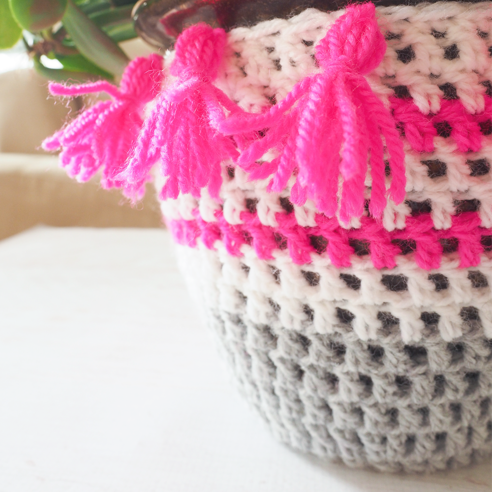 These Crochet Plant Pot Covers are so colorful, and a great way to liven up any room. #crochetpattern #crochetplantpotcover #crochetproject #crochetlove #crochetaddict