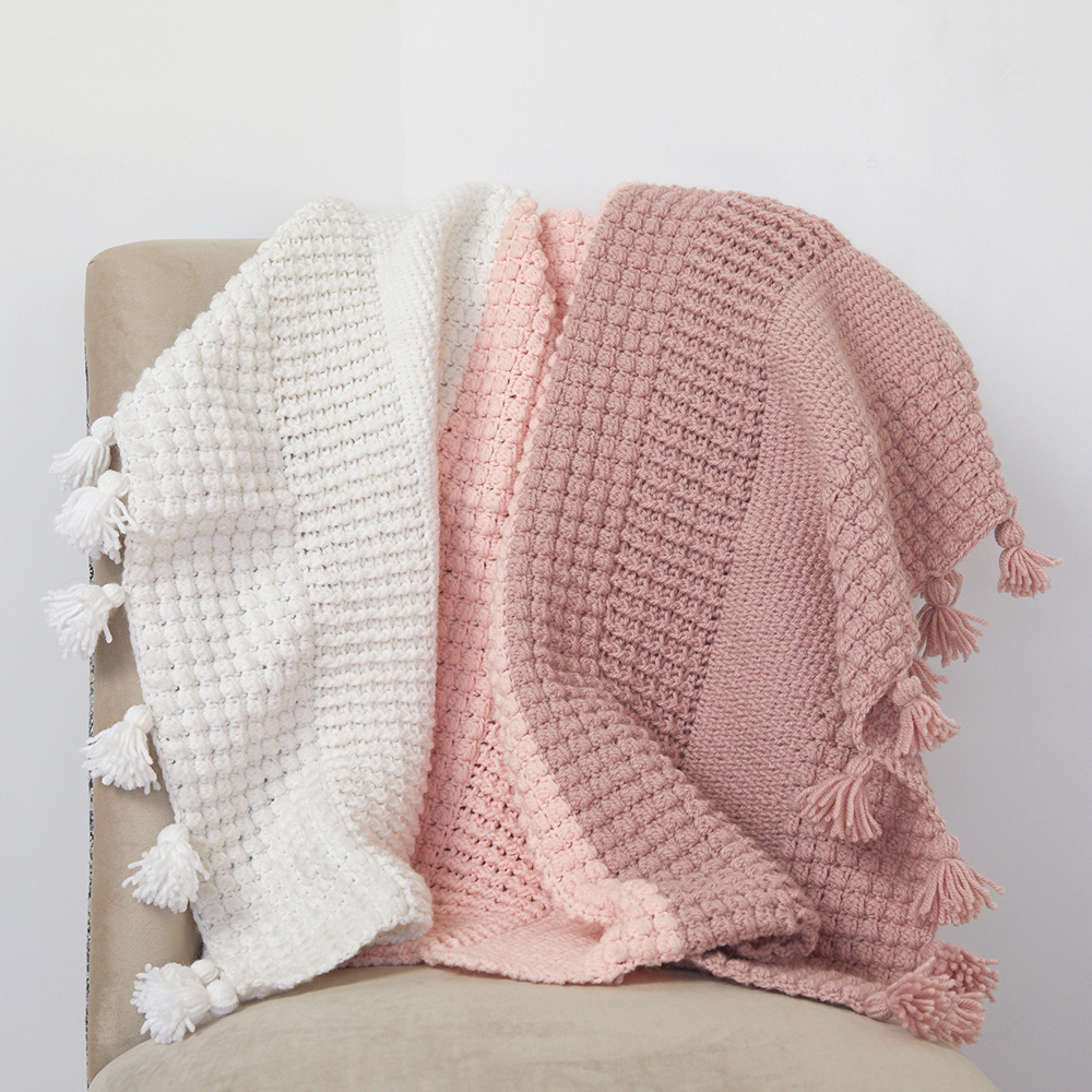 Are you looking for the perfect crochet blanket pattern. The Ombre Textured crochet afghan blanket uses different crochet stitches to create stunning texture. #crochetblanket #crochetpattern #crochetlove #crochetaddict