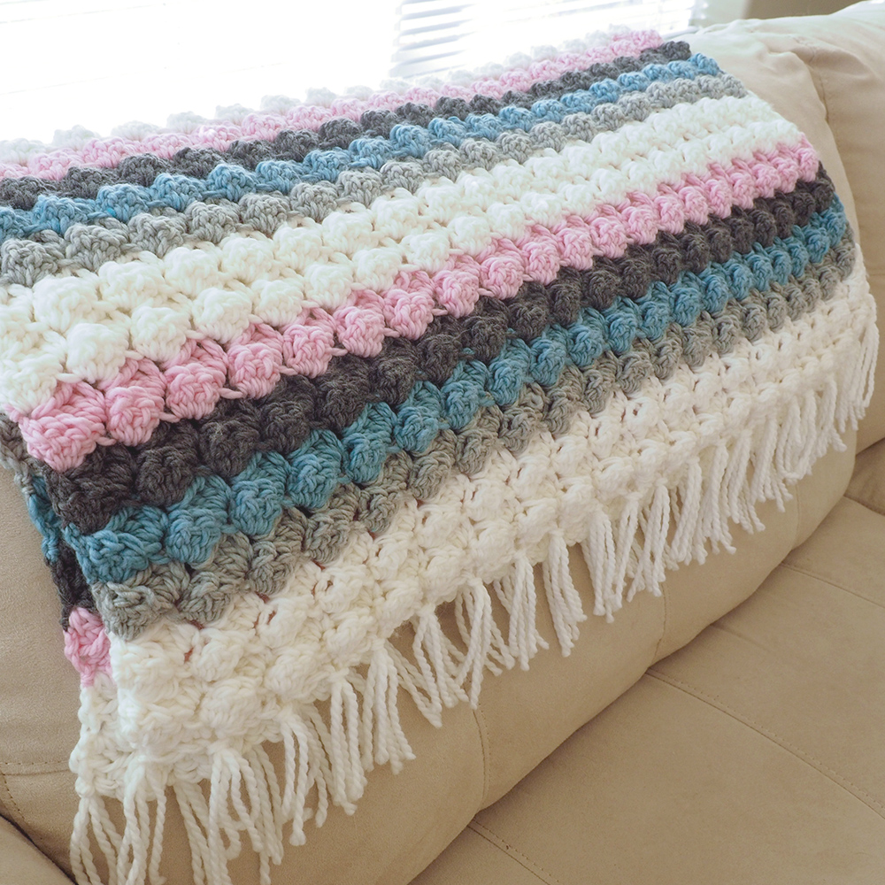 This Baby Bumps Crochet Blanket is the perfect gift for a baby shower or for a baby's first Christmas. #crochetbabyblanket #crochetblanket #crochetpattern #crochetlove #crochetaddict
