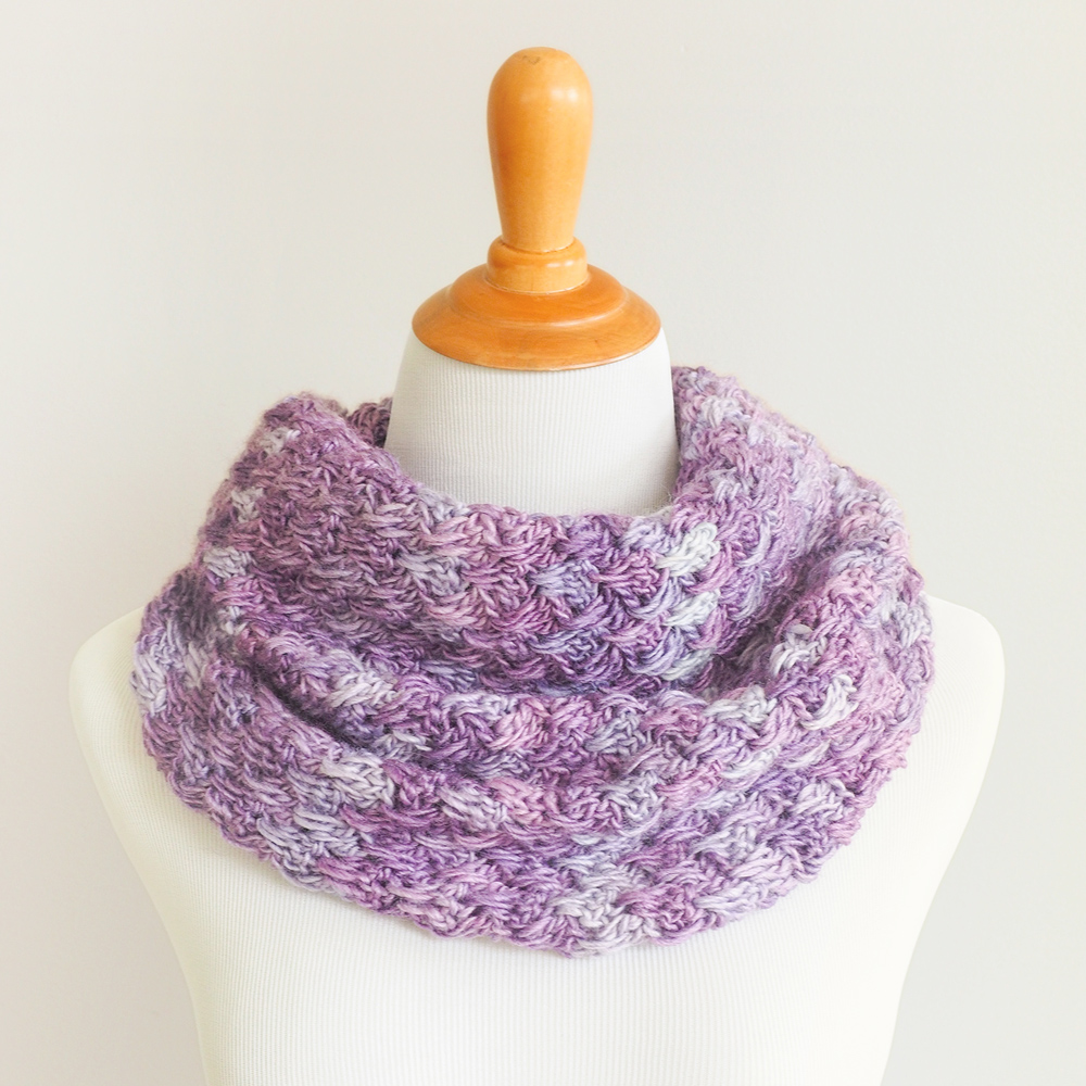 The Lily Crochet Cowl used the Lily of the Valley stitch. This stitch is so easy. It's only a series of double crochets in a one row repeat but it looks complex and impressive. #crochetcowl #crochetgift #crochetaddict #freecrochetpattern