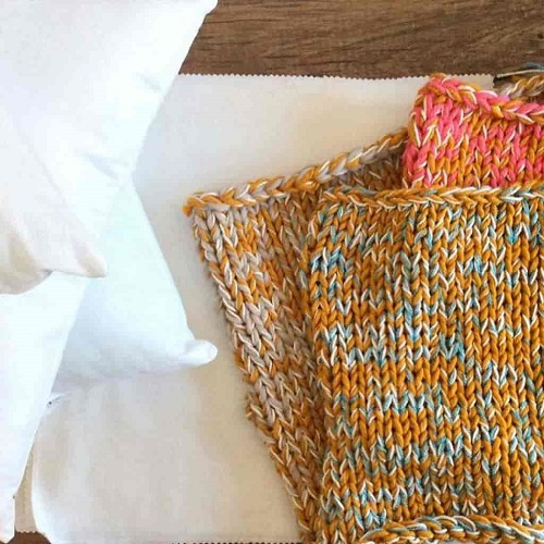 Chunky Knit Pillow - Crochet and knitting are crafts that use knitting yarn and stitchwork to create garments and other projects. And both methods have loads of benefits. #crochet #knitting #knittingvscrochet