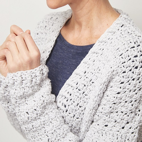 This easy wear crochet cardigan is easy to make and perfect for a first garment. It has a boxy shape with ribbed banding around the bottom and neckline. #crochetcardigan #crochetpattern #easycrochetpattern #freecrochetpattern
