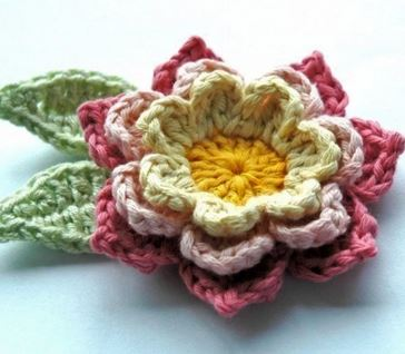 Blooming Crochet Flowers and Leaves - Check this list of easy crochet patterns that is full of simple flowers and even has a crochet rose pattern. All the warmth of spring at your fingertips. #flowerpattern #crochetflower #easycrochetpatterns #crochetideas