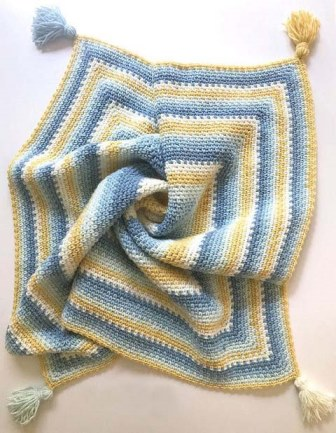 Moss Stitch in a Square Crochet Blanket - Test out your knowledge of the moss stitch with these crochet patterns. These crochet stitch patterns are unique and colorful, and worthy of your time. #crochetstitches #crocheting #mossstitch #learntocrochet