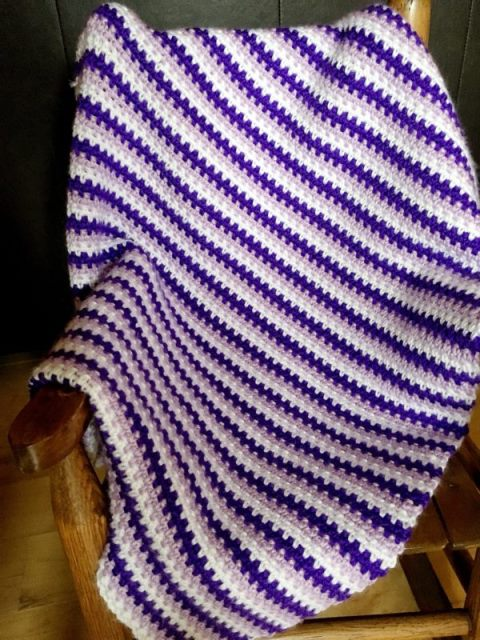 Pattern Princess Moss Stitch Baby Blanket - Test out your knowledge of the moss stitch with these crochet patterns. These crochet stitch patterns are unique and colorful, and worthy of your time. #crochetstitches #crocheting #mossstitch #learntocrochet