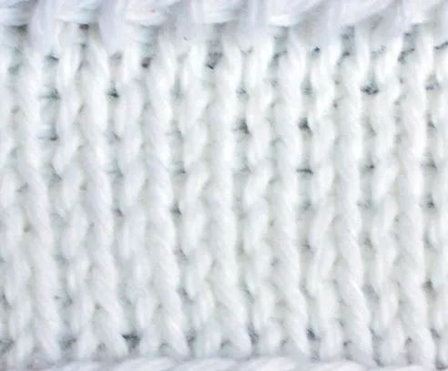 Tunisian Knit Stitch - Tunisian crochet bridges the gap between crochet and knitting. You should test it out with this list of Tunisian crochet stitches we've put together. #TunisianCrochet #TunisianCrochetStitches #CrochetForBeginners
