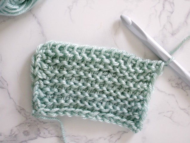 Tunisian Purl Stitch - Tunisian crochet bridges the gap between crochet and knitting. You should test it out with this list of Tunisian crochet stitches we've put together. #TunisianCrochet #TunisianCrochetStitches #CrochetForBeginners