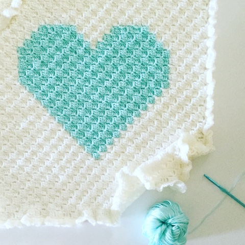 C2C Heart Blanket - This list of C2C crochet patterns will allow you make things you never dreamed of. Your friends will be impressed by your talent and you can make them gifts they could never buy in stores. #C2CCrochet #CornerToCornerCrochet #CrochetPatterns