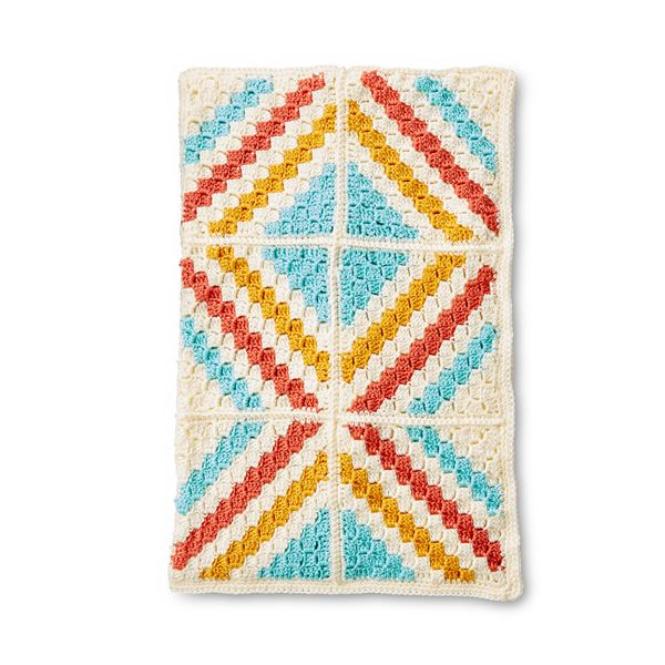 Caron C2C Motifs Blanket - This list of C2C crochet patterns will allow you make things you never dreamed of. Your friends will be impressed by your talent and you can make them gifts they could never buy in stores. #C2CCrochet #CornerToCornerCrochet #CrochetPatterns