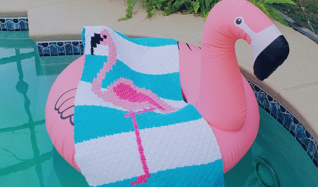 The Flamingo Towel - This list of C2C crochet patterns will allow you make things you never dreamed of. Your friends will be impressed by your talent and you can make them gifts they could never buy in stores. #C2CCrochet #CornerToCornerCrochet #CrochetPatterns