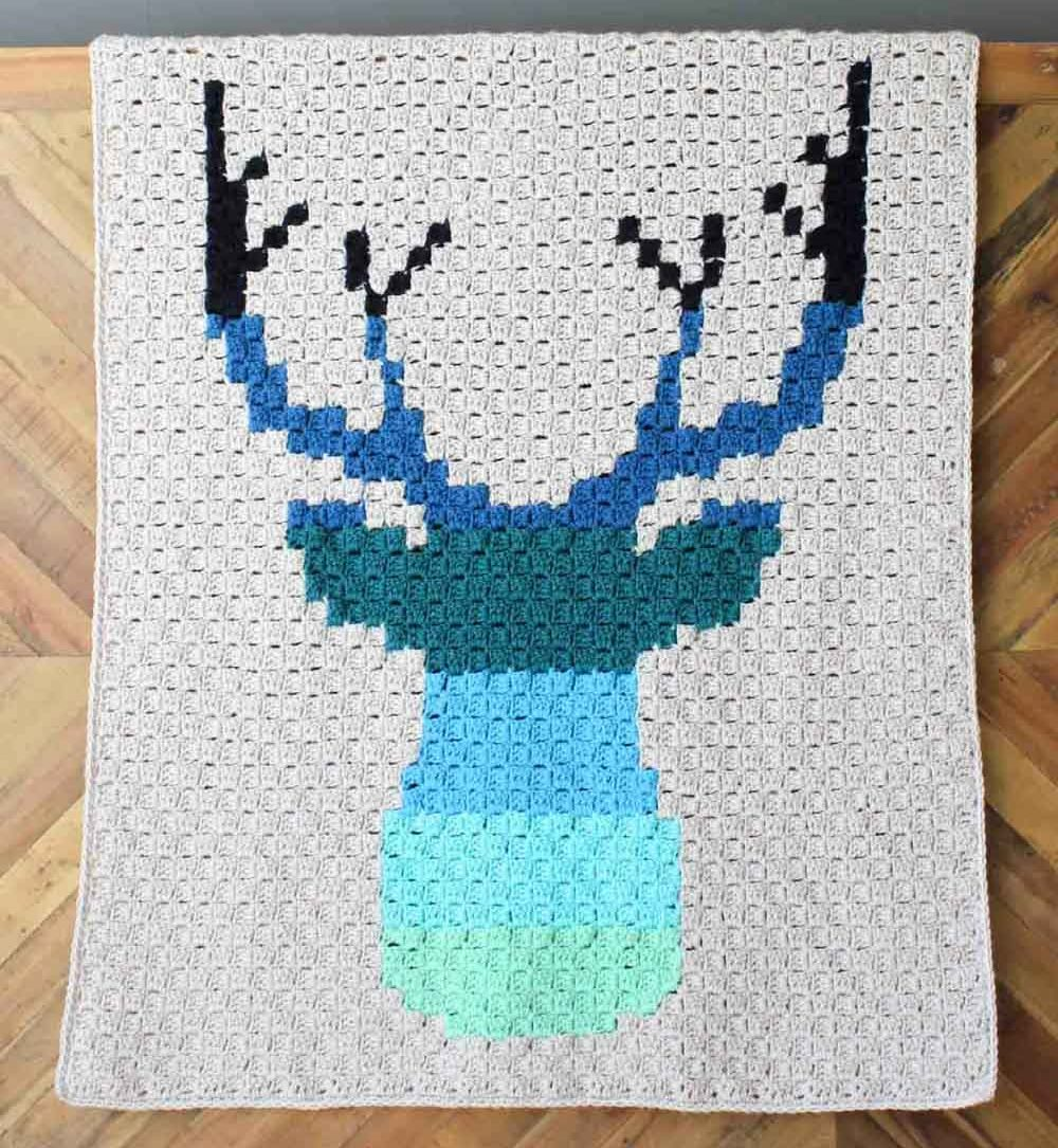 C2C Deer Afghan - This list of C2C crochet patterns will allow you make things you never dreamed of. Your friends will be impressed by your talent and you can make them gifts they could never buy in stores. #C2CCrochet #CornerToCornerCrochet #CrochetPatterns