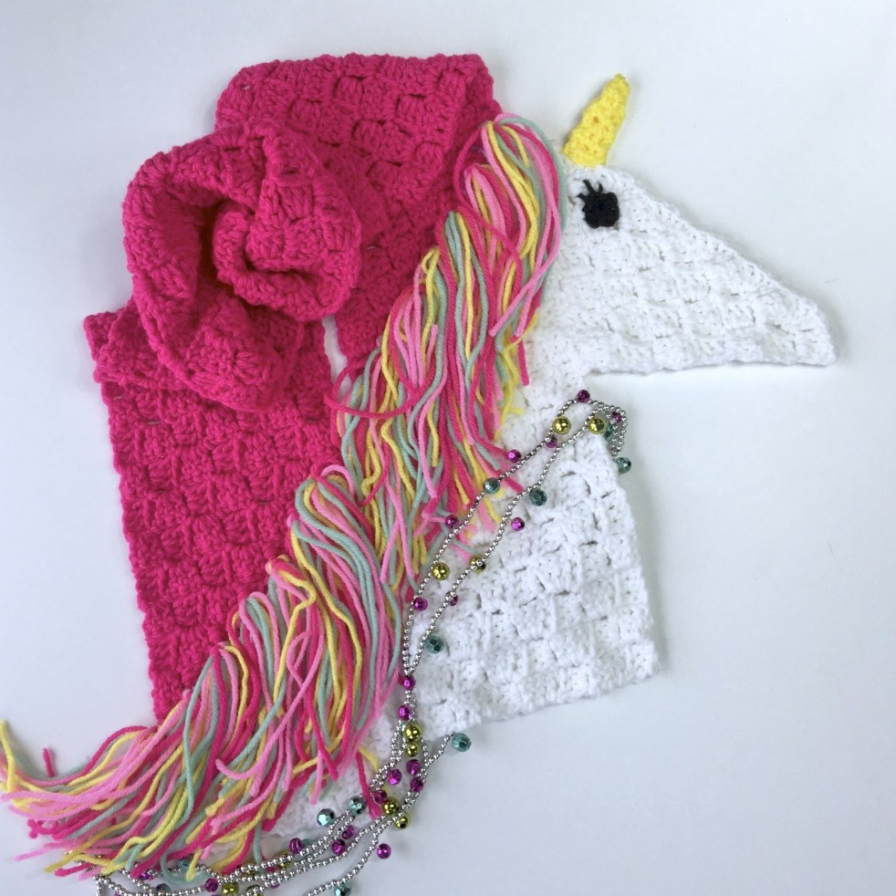 C2C Unicorn Scarf - This list of C2C crochet patterns will allow you make things you never dreamed of. Your friends will be impressed by your talent and you can make them gifts they could never buy in stores. #C2CCrochet #CornerToCornerCrochet #CrochetPatterns