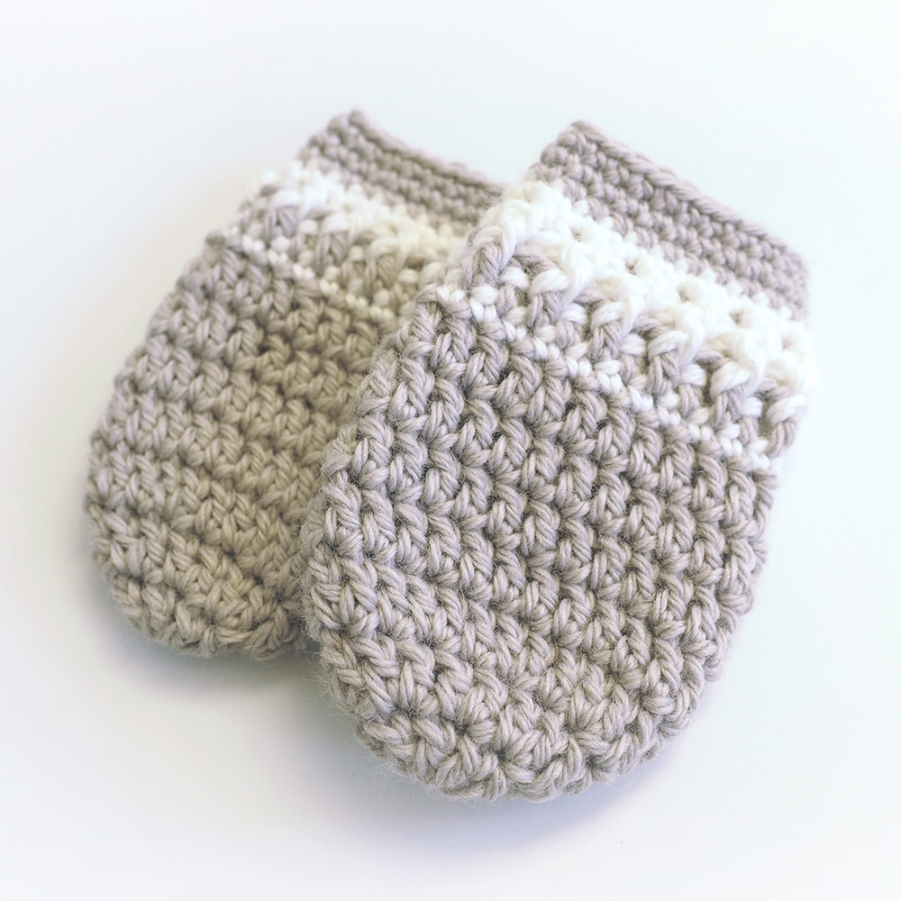 This crochet baby mittens pattern is sweet and unique. It uses basic crochet stitches like single crochet and double crochet. #CrochetBabyMittens #CrochetMittens #CrochetPattern
