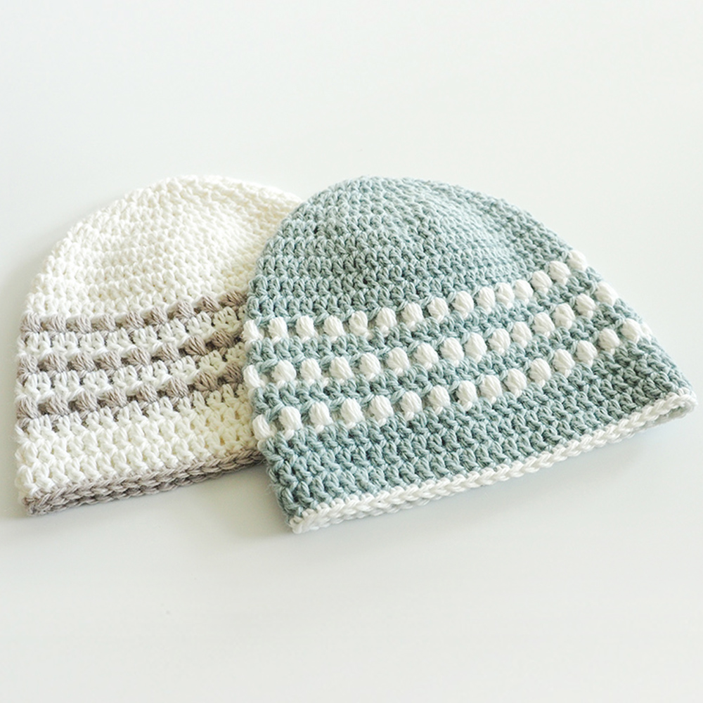 Learn how to crochet a baby hat with this puff stitch pattern. It's easy and fun and looks gorgeous. It's also perfect for any gender. #CrochetHat #CrochetBabyHat #PuffStitchCrochet