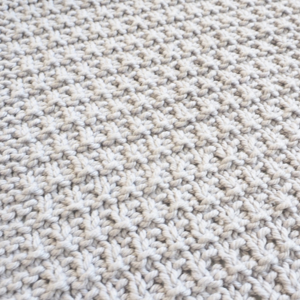 If you're looking to try knitting for beginners, this Rib Ridge knit dishcloth pattern is perfect. Simple patterns like this help you practice the knit stitch and the purl stitch. #KnittingPattern #KnittingForBeginners #EasyKnittingPattern