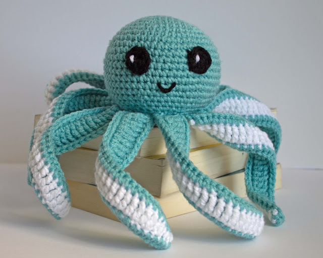 Amigurumi Octopus Baby Toy - These free amigurumi patterns and crochet toys are so fun, it will make you want to be a kid again. These cute patterns are imaginative and sweet. #AmigurumiPatterns #CrochetPatterns #FreeCrochetPatterns