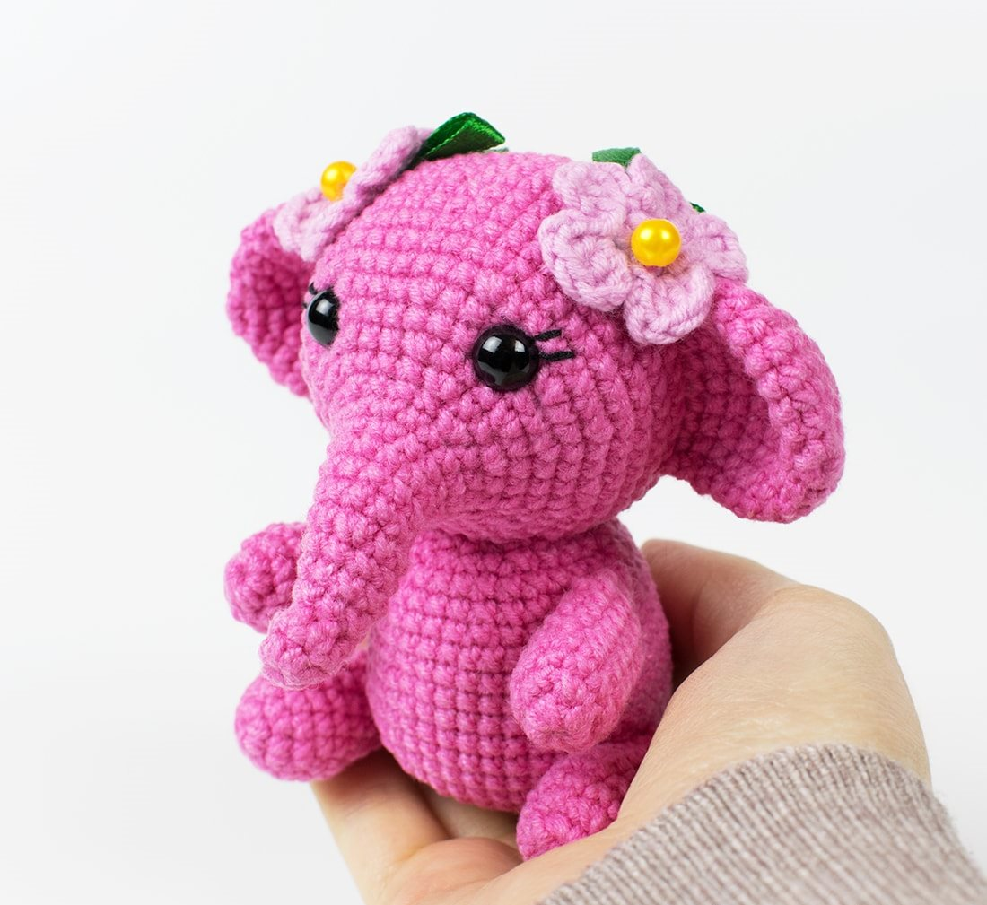 Pink Crochet Elephant - These free amigurumi patterns and crochet toys are so fun, it will make you want to be a kid again. These cute patterns are imaginative and sweet. #AmigurumiPatterns #CrochetPatterns #FreeCrochetPatterns