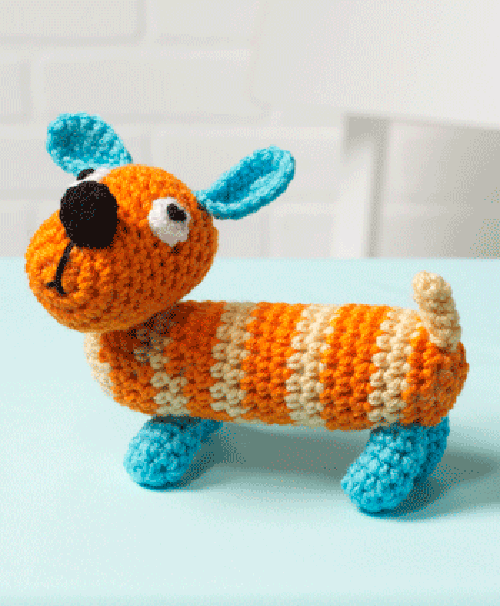 Sam the Dog - These free amigurumi patterns and crochet toys are so fun, it will make you want to be a kid again. These cute patterns are imaginative and sweet. #AmigurumiPatterns #CrochetPatterns #FreeCrochetPatterns