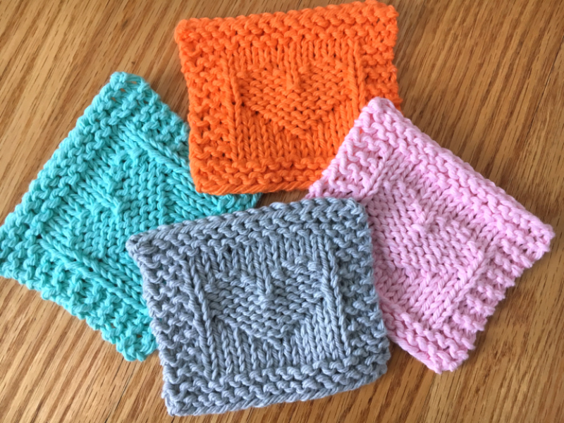 Heart Face Scrubbie - These knitting patterns are fun and diverse. There are so many options to choose from and most of them make great easy knitting projects for beginners. #KnittingPatterns #EasyKnittingProjects