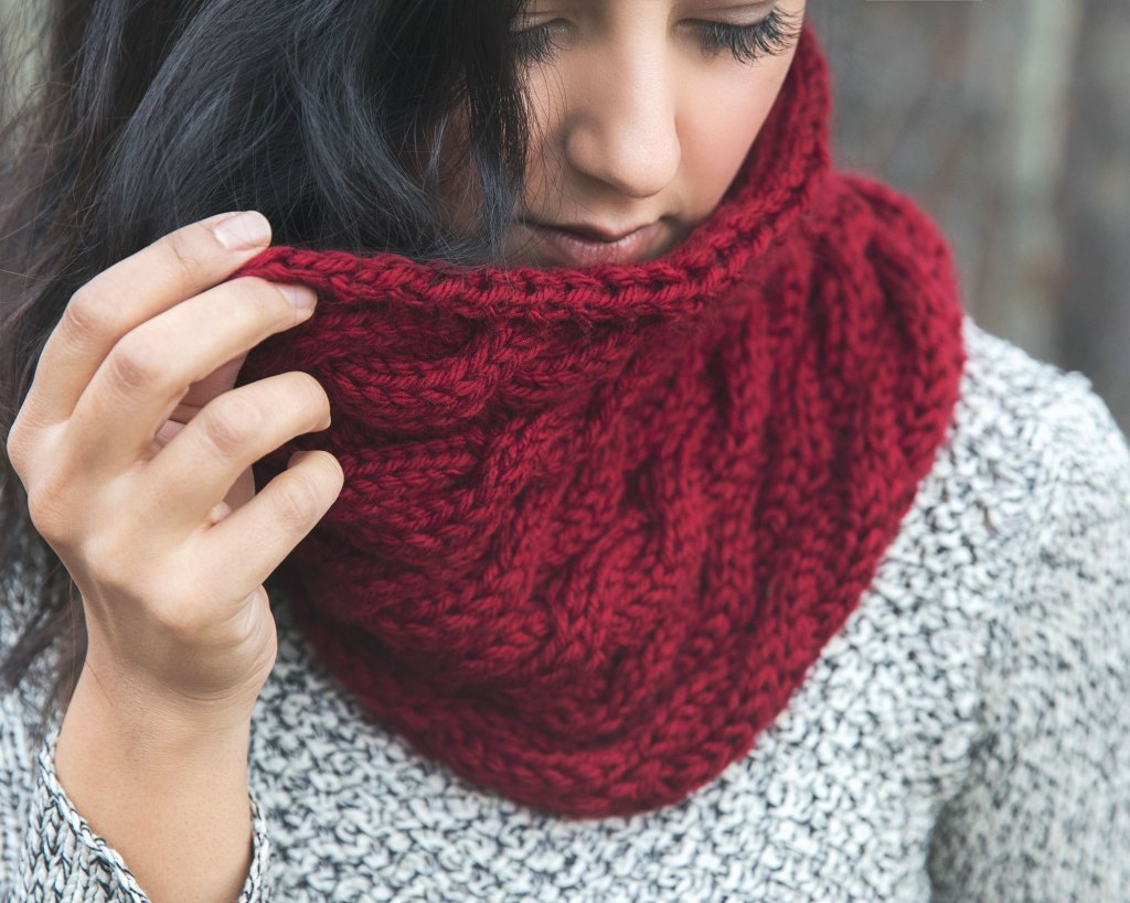 Chunky Cabled Cowl - We've gathered here 10 of the easiest patterns for first-time knitters to tackle that most fascinating of knitting wonders - cables! #cableknitting #cableknits #knittingpatterns