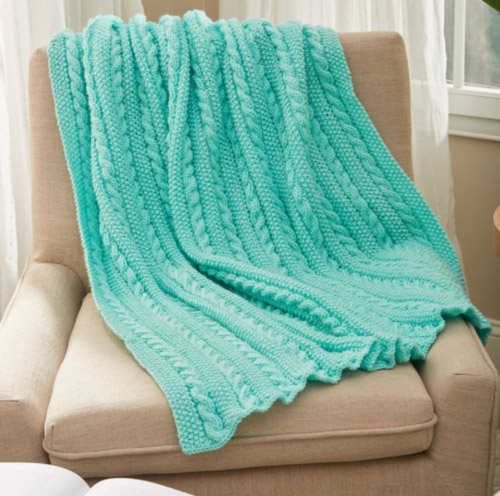 Easy Cable Knit Blanket - We've gathered here 10 of the easiest patterns for first-time knitters to tackle that most fascinating of knitting wonders - cables! #cableknitting #cableknits #knittingpatterns