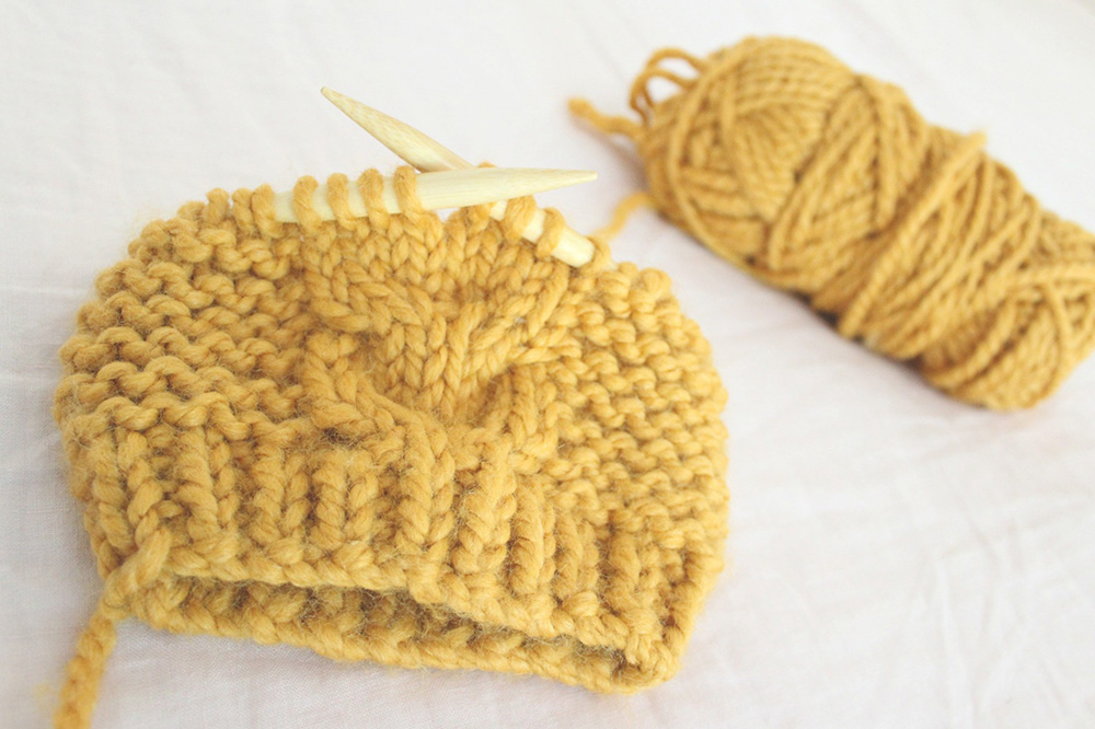 Super Bulky Toddler Cable Hat - We've gathered here 10 of the easiest patterns for first-time knitters to tackle that most fascinating of knitting wonders - cables! #cableknitting #cableknits #knittingpatterns
