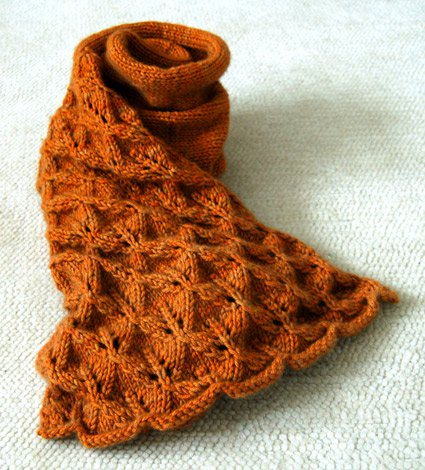 Lovely Leaf Lace Scarf - We've gathered here 21 cozy scarf knitting patterns that you can knit quickly, just in time for fall and impending winter. #ScarfKnittingPatterns #KnittingPatterns #ScarfPatterns