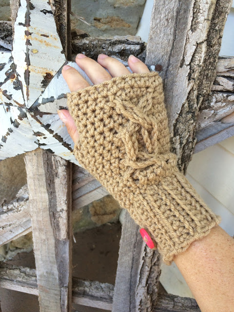 Chrissy's Cabled Fingerless Gloves - This list of 20 easy fingerless gloves crochet patterns is suitable for everyone, including males, females, adults, and children. #FingerlessGlovesCrochetPatterns #CrochetFingerlessGloves #CrochetPatterns