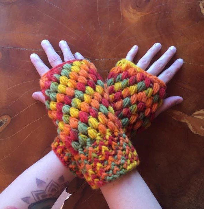 Puff Stitch Fingerless Gloves - This list of 20 easy fingerless gloves crochet patterns is suitable for everyone, including males, females, adults, and children. #FingerlessGlovesCrochetPatterns #CrochetFingerlessGloves #CrochetPatterns