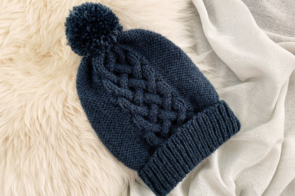 Interwoven Hat - From casual to designer styled hats, these free knit hat patterns on circular needles are sure to be your new favorite projects to work on! #freeknithatpatterns #knithatpatterns #knitpatterns