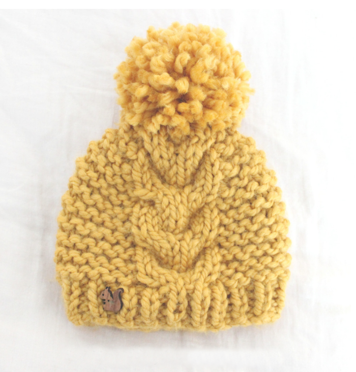Super Bulky Toddler Cable Hat - From casual to designer styled hats, these free knit hat patterns on circular needles are sure to be your new favorite projects to work on! #freeknithatpatterns #knithatpatterns #knitpatterns
