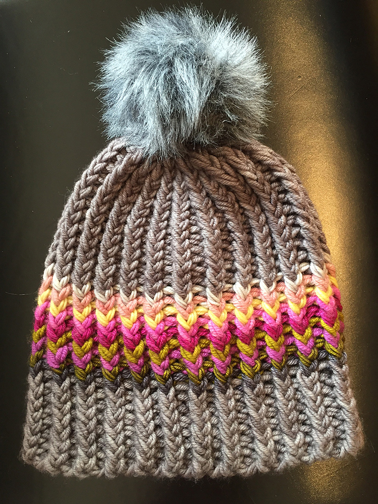 Twisted Ribster Hat - From casual to designer styled hats, these free knit hat patterns on circular needles are sure to be your new favorite projects to work on! #freeknithatpatterns #knithatpatterns #knitpatterns