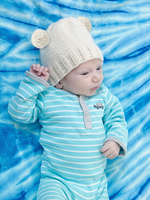 Baby Archie Bear Hat - These 27 knitting patterns for babies range from diaper covers, booties, blankets, to hats and headbands. #knittingpatterns #babyknittingpatterns #adorableknittingpatterns