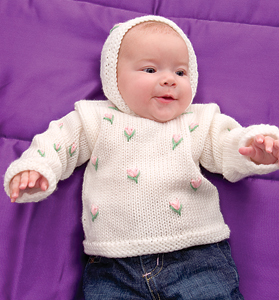 Baby Hoodie with Rosebuds - These 27 knitting patterns for babies range from diaper covers, booties, blankets, to hats and headbands. #knittingpatterns #babyknittingpatterns #adorableknittingpatterns