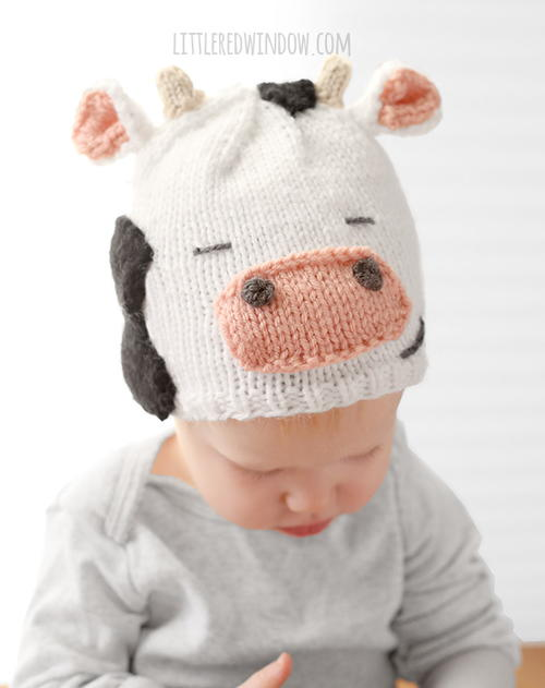 Cuddly Cow Hat - These 27 knitting patterns for babies range from diaper covers, booties, blankets, to hats and headbands. #knittingpatterns #babyknittingpatterns #adorableknittingpatterns