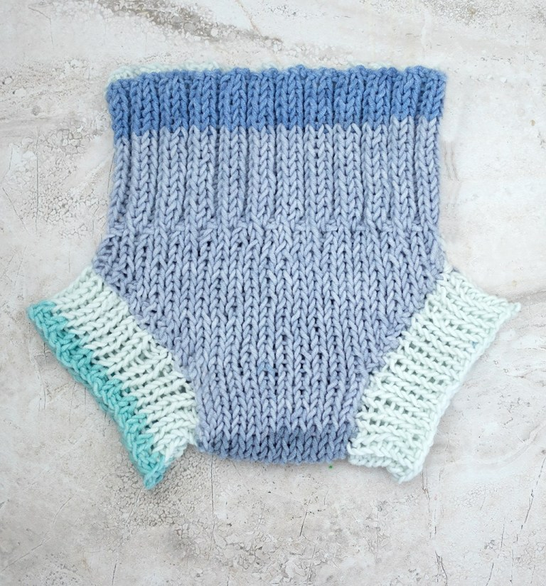Knit Diaper Cover - These 27 knitting patterns for babies range from diaper covers, booties, blankets, to hats and headbands. #knittingpatterns #babyknittingpatterns #adorableknittingpatterns