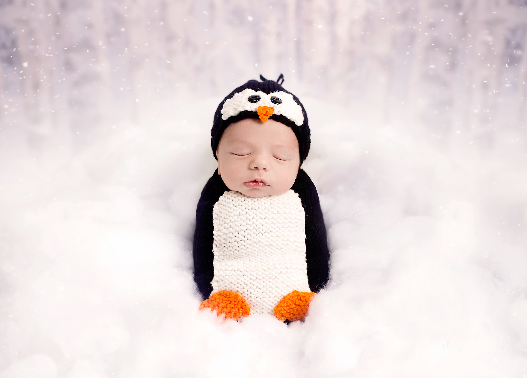 Poppy Penguin Knit Pattern - These 27 knitting patterns for babies range from diaper covers, booties, blankets, to hats and headbands. #knittingpatterns #babyknittingpatterns #adorableknittingpatterns