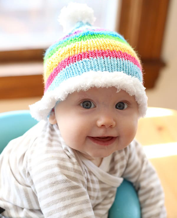 Rainbow Skies Baby Hat - These 27 knitting patterns for babies range from diaper covers, booties, blankets, to hats and headbands. #knittingpatterns #babyknittingpatterns #adorableknittingpatterns