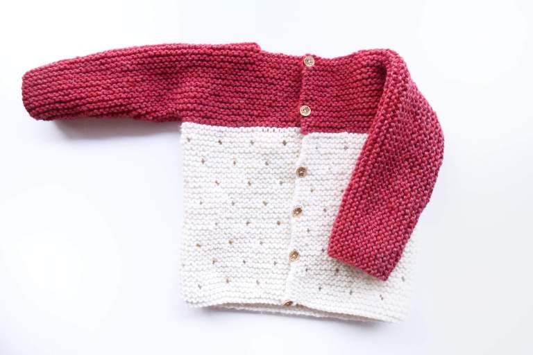 Strawberry Seed Baby Sweater - These 27 knitting patterns for babies range from diaper covers, booties, blankets, to hats and headbands. #knittingpatterns #babyknittingpatterns #adorableknittingpatterns