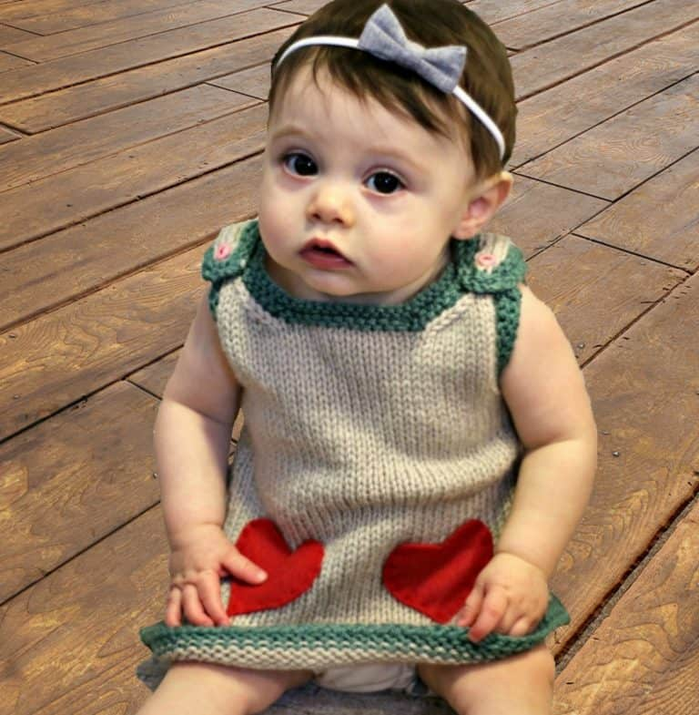 Valentine Baby Dress - These 27 knitting patterns for babies range from diaper covers, booties, blankets, to hats and headbands. #knittingpatterns #babyknittingpatterns